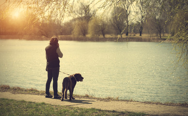 Woman in the park with her dog