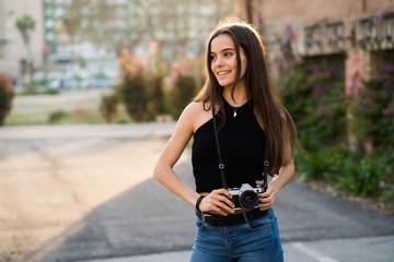 Pretty woman using a DSLR camera