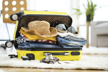 Fototapeta Preparation travel suitcase at home obraz
