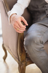 Bridegroom sitting on chair