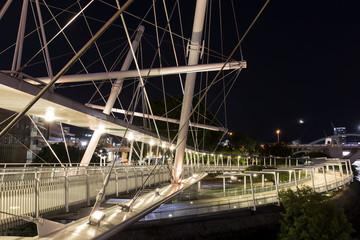 Kurilpa Bridge illuminated spiral pedestrian walkway and Kurilpa Point Park