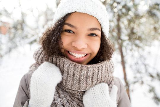 Laughing African American girl walking in winter
