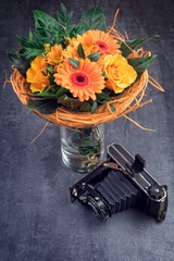 bouquet and old camera
