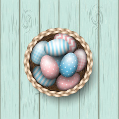 Basket with painted easter eggs on blue wooden background, illustration
