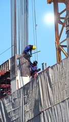 Two workers on the construction site.