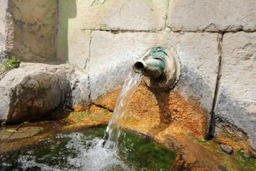 Stone fountain mountain water