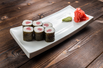 Traditional japanese sushi roll with tuna. As a whole background.