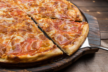 Pizza with Ham and Salami. Garnished with Olives