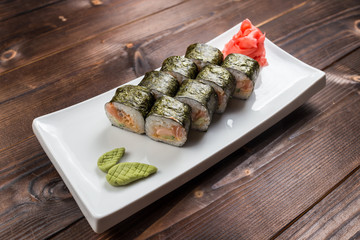 Maki rolls with smoked salmon with wasabi on back front