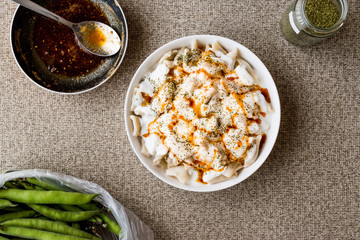 Turkish Manti Manlama / Ravioli with yogurt and fried butter sauce. copy space.