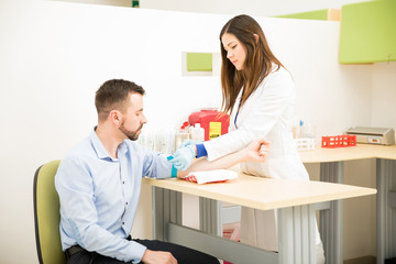 Doctor preparing a patient for drawing blood