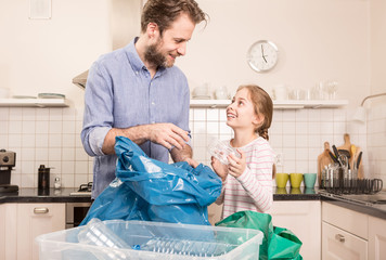 Recycling - family sorting (segregating) household waste