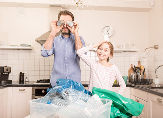 Recycling - family having fun while sorting waste
