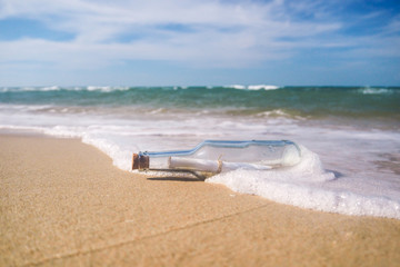 Message in a bottle with beach
