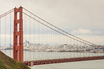 The Golden Gate Bridge and San Francisco Skyline. Kirby Cove, Sausalito, Marin County, California, USA.