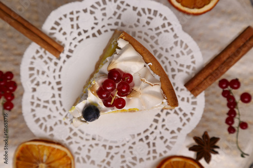 """Piece of lemon tart with a meringue and red currant ..."
