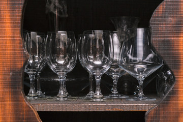 Crystal wine glasses arranged in a cupboard