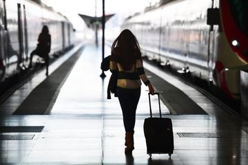 Silhouette on the railway platform in the morning