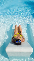 Summer vacation relax and sunbathing in resort swimming pool