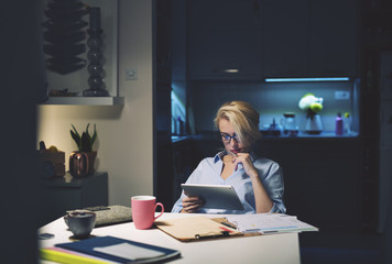 Businesswoman using tablet computer while sitting at desk