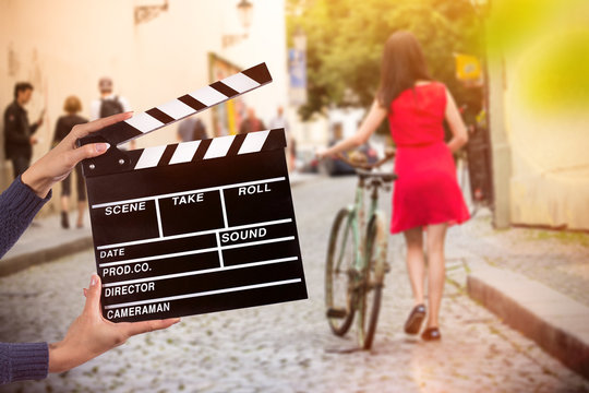Clapperboard sign hold by female hands.