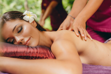 Beautiful woman receiving a back massage at spa