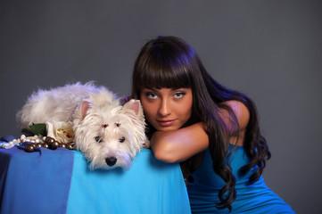 Caucasian prime adult female holding white terrier dog.