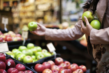 Cropped image of woman buying fruits at store