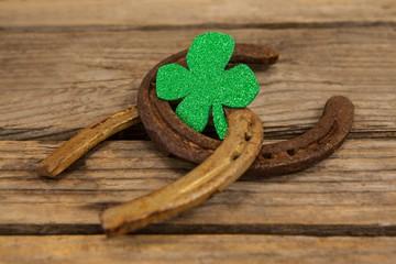 St Patricks Day shamrock with two horseshoes