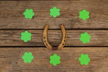 St Patricks Day shamrocks surrounded with horseshoe