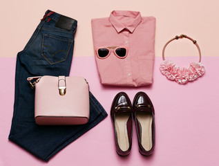 Romantic clothes set. City casual fashion. Spring. Stylish accessories. Pink shirt. Jeans. Bag. Bijouterie for Lady
