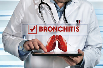pneumologist working with tablet in the lab with diagnostic bronchitis / doctor holding tablet pc in the clinic with diagnosis bronchitis
