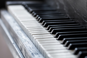 an old piano keys with a selective focus