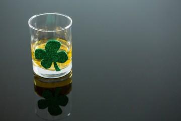 St Patricks Day glass of whisky with shamrock
