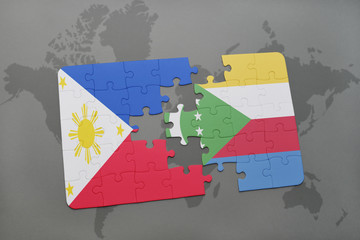 puzzle with the national flag of philippines and comoros on a world map