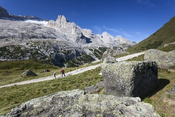 Hiking along the path of Padon Hut, Marmolada in the background, Dolomites, Italy