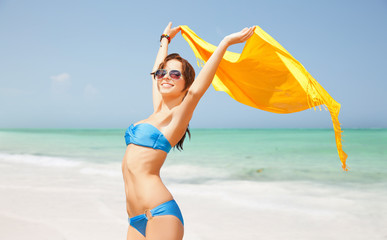 5055e1ee9824b woman in bikini and sunglasses with pareo on beach