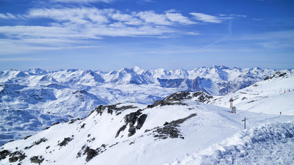 Les Menuires ,Alps, France, ski slopes in 3 Valleys winter sport resort, with snowy mountain peaks panorama .