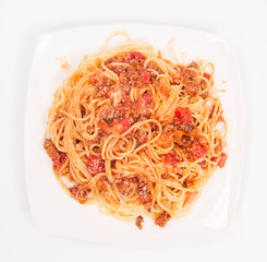 Spaghetti bolognese on a white background