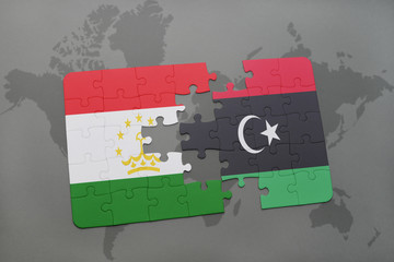puzzle with the national flag of tajikistan and libya on a world map