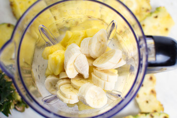 Sliced pineapple and banana in blender
