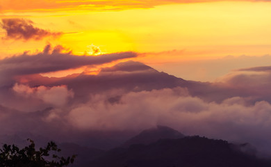 foggy orange sunset in the mountains in Colombia