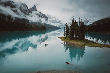 Canoeing near Spirit Island on Maligne Lake