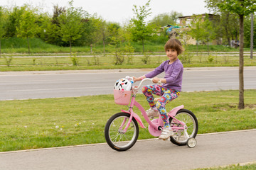 Girl learning to ride her bike