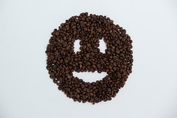 Coffee beans forming smiley face