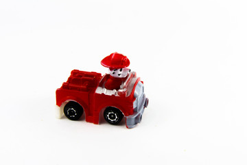Children's toys and figurines on a white background