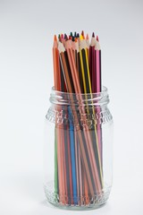 Colored pencils kept in a glass jar