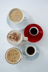Different types of coffee arranged on white background