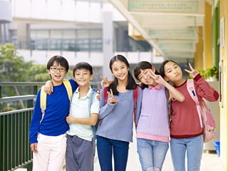 group of happy asian elementary school student