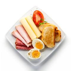 Breakfast - eggs, toast, ham and cheese
